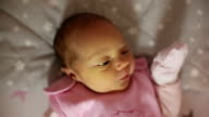 Slow motion. Close up face of a newborn girl with jaundice. video