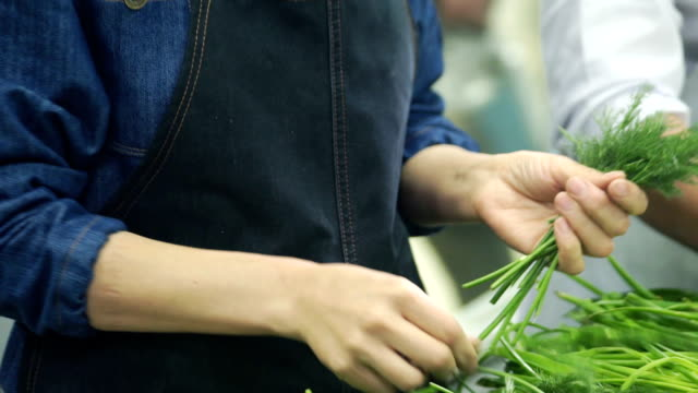 slow motion cookers plucked dill in industrial kitchen at restaurant video