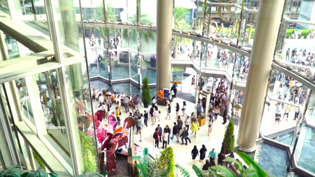 slow motion: crowd of travellers is comming to shopping mall video