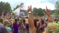 Slow motion, crowd putting hands up in air, festival atmosphere video