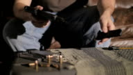 Slow Motion Disassembling a .45 Caliber Semi-Automatic Gun video