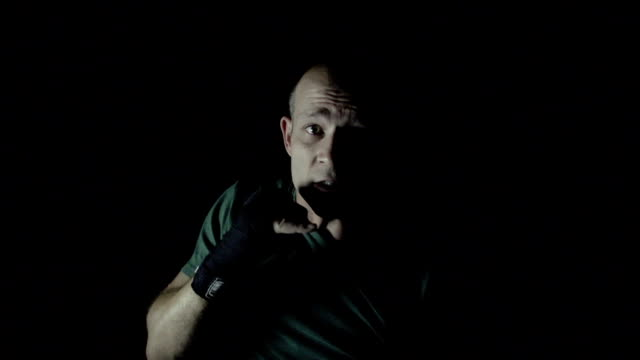 Slow Motion Dramatic boxing, man punching at camera video