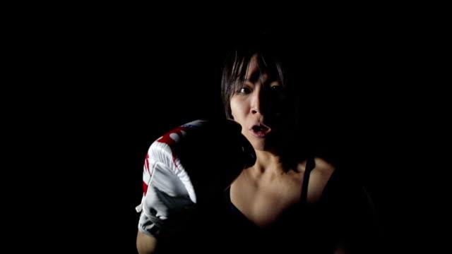 Slow Motion Dramatic Woman Boxing, Punching Camera POV video