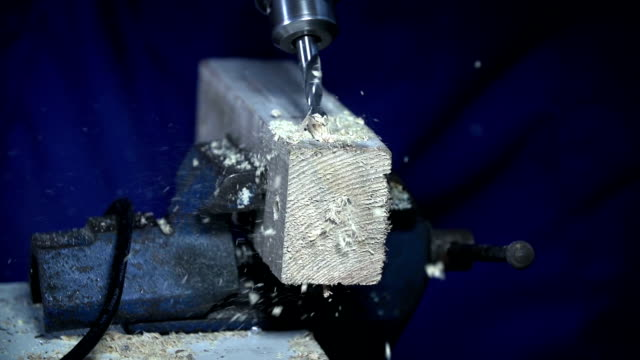 HD SLOW: Slow motion drilling through wood video