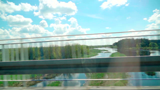 Slow motion: driving a car bridge and river video