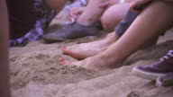 Slow motion feet on the beach keeping time video