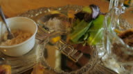 Slow motion fly over of a silver passover seder plate video