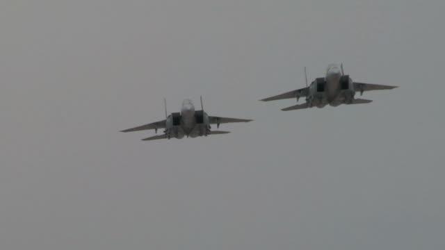 F-15 slow motion flybys in desert. video