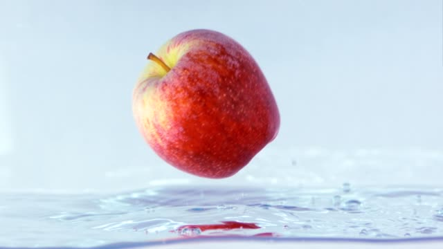 Slow Motion Footage Of An Apple Bumping And Rolling On Water. video