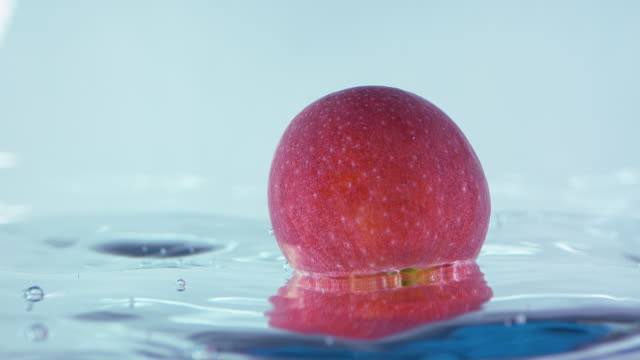 Slow Motion Footage Of An Apple Falling In Water video