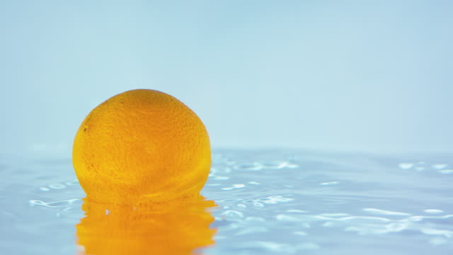 Slow Motion Footage Of An Orange Floating On Water Surface video