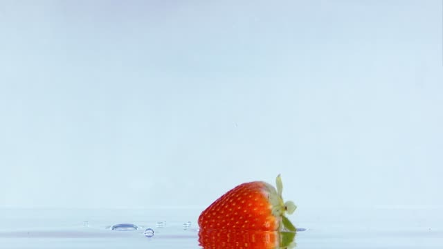Slow Motion Footage Of Strawberry Falling In Water. video