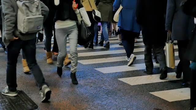 Slow motion - Footsteps of pedestrians crossing the Shibuya crosswalk in Tokyo, Japan video