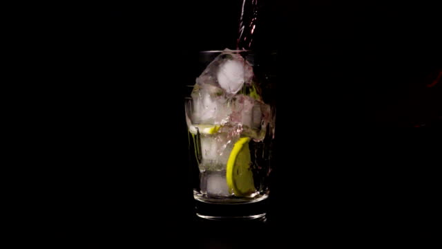 Slow motion glass with ice and lemon video
