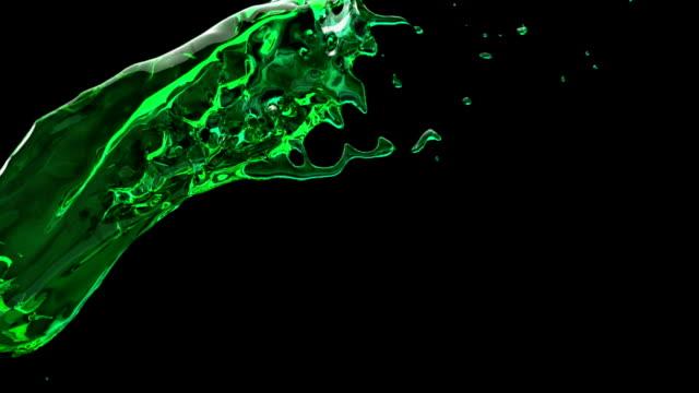 Slow motion green liquid splash video