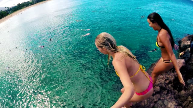POV GOPRO HD Slow Motion Group of Girls in Bikinis jumping from cliff into the ocean in Hawaii. video