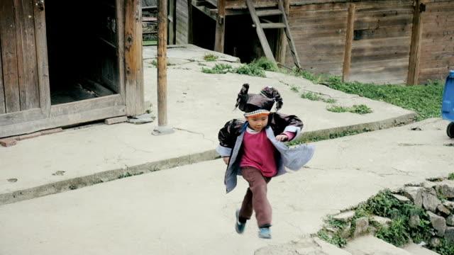 Slow motion happy village boy running video