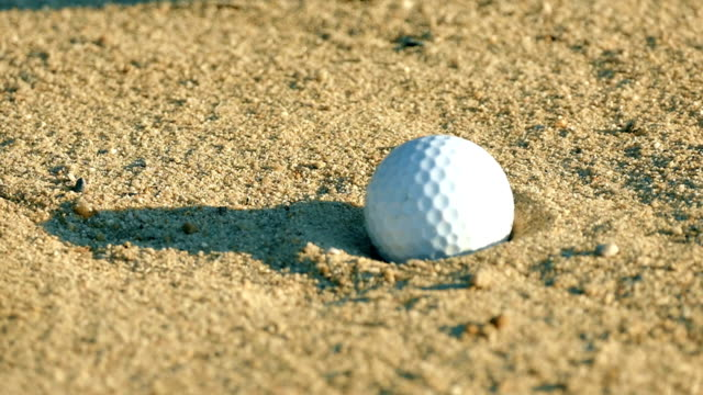 Slow Motion Hitting golf Ball From Sand Trap video