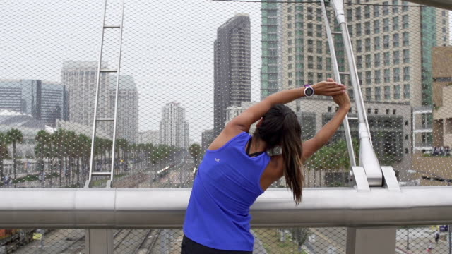Slow Motion Latino Woman Stretching Before Workout video