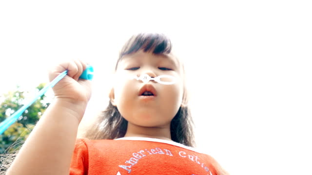 SUPER Slow motion Little Girl Blowing Bubbles video