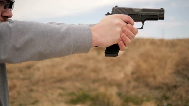 Slow Motion Man Fires Gun Then Admires Shot video