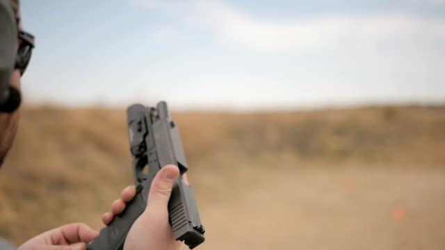 Slow Motion Man Loads and Fires a Handgun video