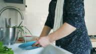 Slow motion Men washing dishes. video