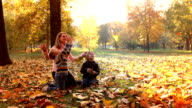 Slow motion: Mother and children in the park video