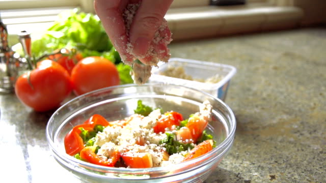 Slow Motion Moving Shot of Person Adding Cheese to Salad video