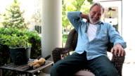 Slow motion neck pain on veranda video