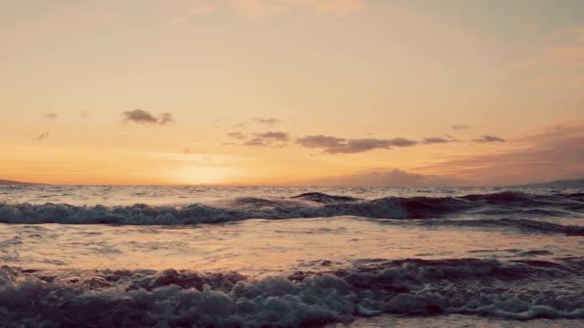Slow Motion Ocean Waves Breaking on Sandy Beach in Hawaii video