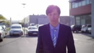 Slow motion of a young sad businessman walking video
