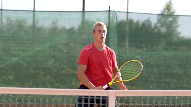 Slow Motion Of Athletic Tennis Player Training On Clay Court video