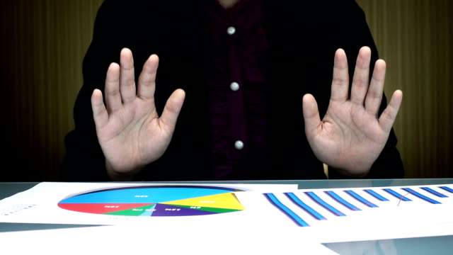 Slow motion of businessperson is waving hands to reject business agreement in the office video