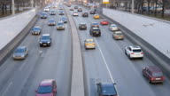 Slow motion of cars, in the evening through the streets of a large city. video