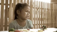 Slow motion of frown little girl, vintage style video