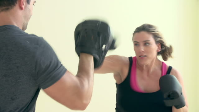 Slow Motion Of Overweight Woman With Personal Trainer video