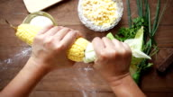 Slow motion of preparing corn for cooking, Top view video