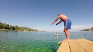 Slow Motion Of Professional Male Swimmer Jumping Off The Pier video