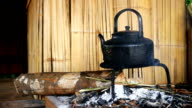 Slow motion of retro kettle on kiln in Indigenous houses video