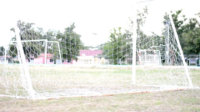 slow motion of soccer ball in goal video