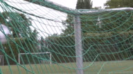 Slow motion of soccer ball into the net video