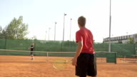 Slow Motion Of Tennis Players Training On Clay Court video