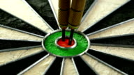 Slow motion of three darts hitting the bull's eye on a dart board and player's hand picking them up video
