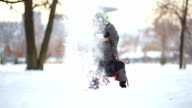 Slow Motion Of Young Boy Throwing Snow Happily video