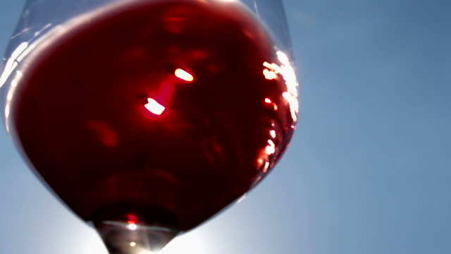 Slow Motion Outdoors Glass Of Italian Wine Swirling In A Glass video