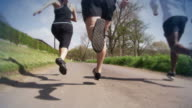 Slow motion people outside running video