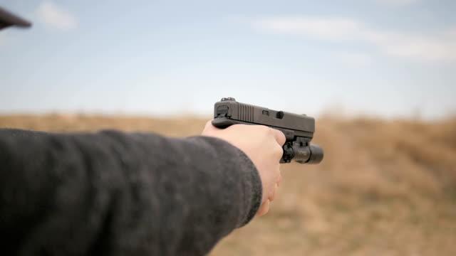 Slow Motion Person Fires Gun video