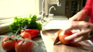 Slow Motion Person Prepares Food Slices Red Tomato video