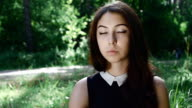 slow motion portrait of young attractive brunette at forest background video